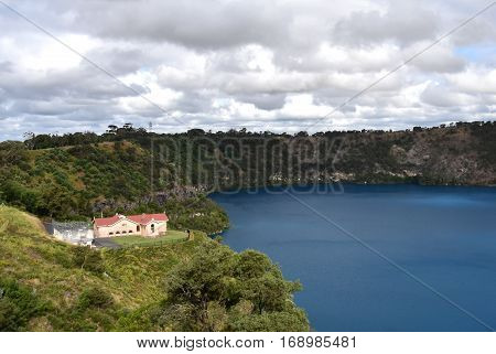 The incredible Blue Lake with the original pumping station at Mt Gambier South Australia. The Blue Lake is a large monomictic crater lake located in a dormant volcanic maar associated with the Mount Gambier maar complex.