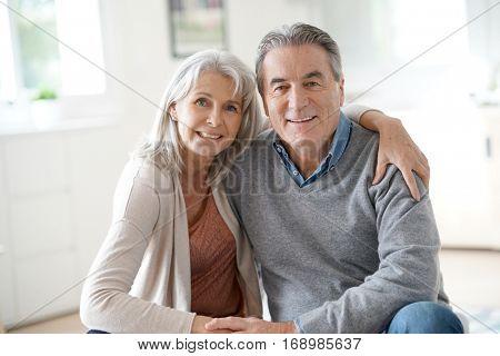Portrait of senior couple relaxing in sofa