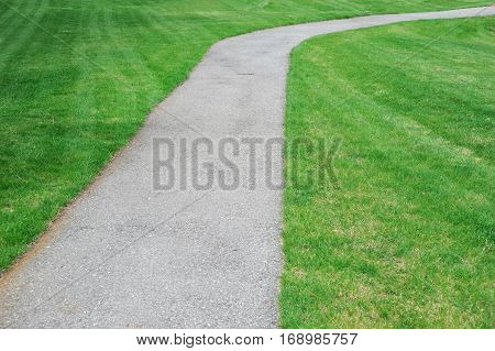 curved pathway in the green meadow for design