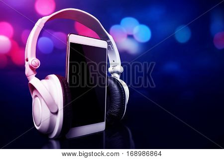 Modern device portable equipment smartphone with headphones