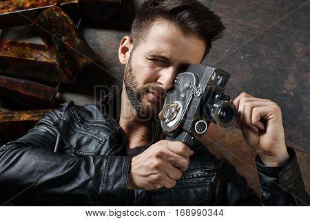 Caucasian man using vintage film camera.