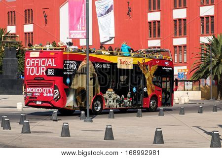 MEXICO CITY,MEXICO - DECEMBER 25,2016 : The Turibus, a double decker bus in Mexico City that offers a tour of the city many landmarks