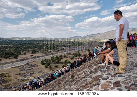 TEOTIHUACAN,MEXICO - DECEMBER 26,2016 : Tourists on top of the Pyramid of the Sun at Teotihuacan in Mexico