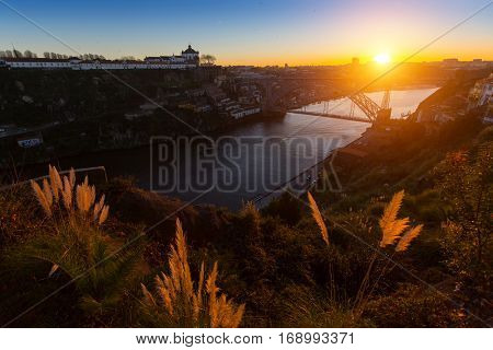 View of the valley of the Douro river and Dom Luis I bridge, Oporto, Portugal.