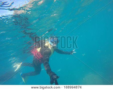 Underwater scuba diving selfie in Great Barrier Reef, Australia