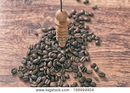 Using pendulum over coffee beans to check its quality