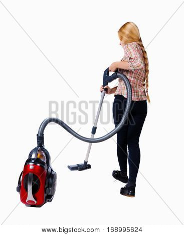 Rear view of a woman with a vacuum cleaner. She is busy cleaning. Rear view people collection.  backside view of person.  Isolated over white background. Cleaner vacuuming with a vacuum cleaner in red