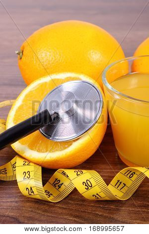Stethoscope, Fresh Orange, Juice And Tape Measure, Healthy Lifestyles And Nutrition