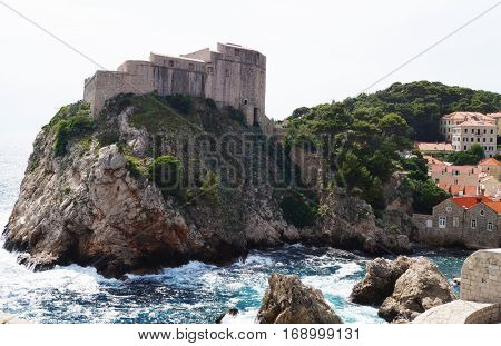 Ancient fortress on ocean cliff