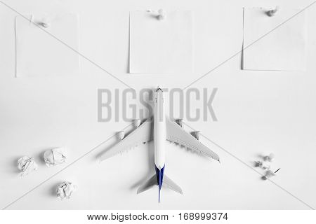 Preparation for Traveling concept and to do list blank paper noted paper ball airplane push pin on white background with copy space.