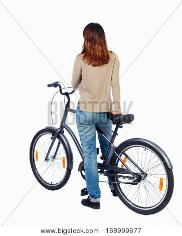 back side view of a woman with a bicycle. cyclist sits on the bike. Rear view people collection.  backside view of person. Isolated over white background. Girl on bike is looking to the side.