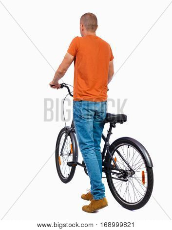 back view of a man with a bicycle. Cyclist keeps the wheel of a bicycle. Rear view people collection.  backside view of person. Isolated over white background. guy in a shirt standing with his bicycle