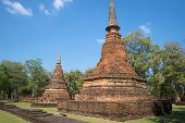 Two chedi on the ruins of ancient Buddhist temple Wat Phra That. Kamphaeng Phet, Thailand poster