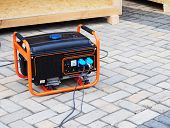 Mobile Gasoline Generator on the Building Site. Mobile Backup Generator. Standby Generator - Outdoor Power Equipment. Standby Generator. poster