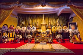 Bangkok, Thailand - December 17, 2011: The Funeral Urn of Phra Phrom Kawee (Worawit Khongkhapunyo) between with the royal wreath in Wat Moli Lokayaram Ratcha Worawihan opened for Buddhist mourners to pay respect.