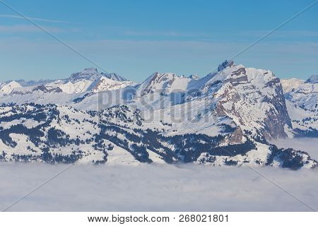 Summits Of The Alps Rising From Sea Of Fog - A Wintertime View From The Fronalpstock Mountain In The