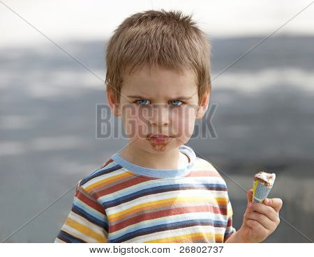 Angry boy wants more ice cream. we all scream for ice cream