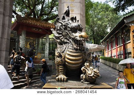 Sculpture Stone Qilin Dragon Guardian At Entrance Of Wong Tai Sin Temple For People Visit And Respec