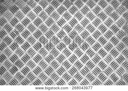Close-up Of A White Colored Wall With Metallic Surface. View To A White Metallic Texture. Geometric