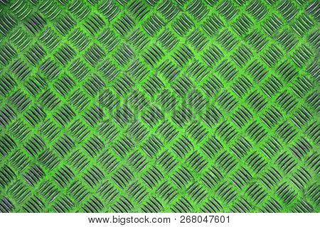 Close-up Of A Green Colored Wall With A Striped Pattern. View To A Neon Green Shiny Metallic Wall. G