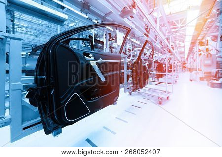 Car Door On Production Line. Factory For Production Of Cars In Blue. Blue Tone