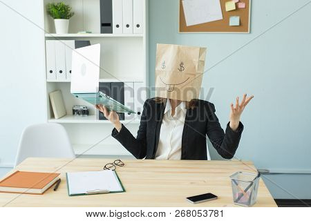 Business, Emotions And Money Concept - Office Crazy Woman Put A Package With Painted Funny Face On H