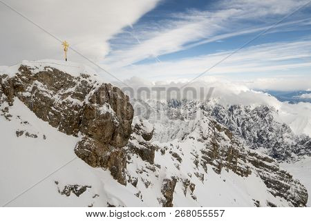 Zugspitze With Summit Cross. The Highest Mountain Of Germany.