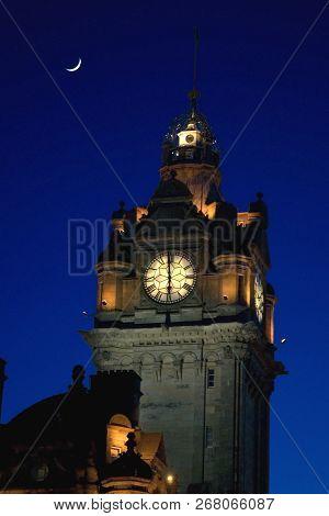Balmoral Clock Tower At Night With Crescent Moon , Edinburgh, Scotland