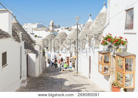 Alberobello, Apulia, Italy - Trulli Street In The Old Town Of Alberobello