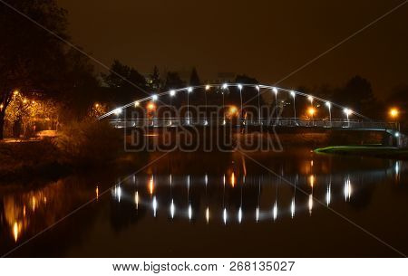 Night View Of Emil Pitter Footbridge For Pedestrians And Cyclists Across The Vltava River In Ceske B