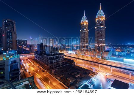 Beautiful View To Dubai And Sheikh Zayed Rd, United Arab Emirates. City Skyline. Long Exposure Time