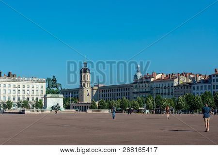 Lyon, France - July 19, 2018: The Bellecour Square In Lyon With Statue Of Louis Xiv. This Is The Cen