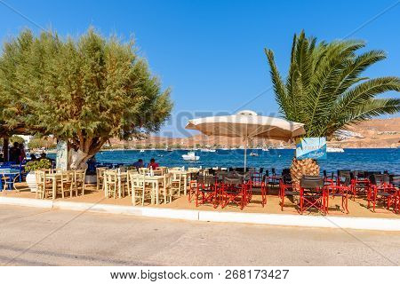 Serifos, Greece - 9 September, 2018: Tables And Chairs In Traditional Greek Taverns Along Seaside Pr