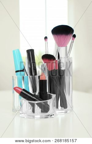 Organizer With Cosmetic Products For Makeup On Table Indoors
