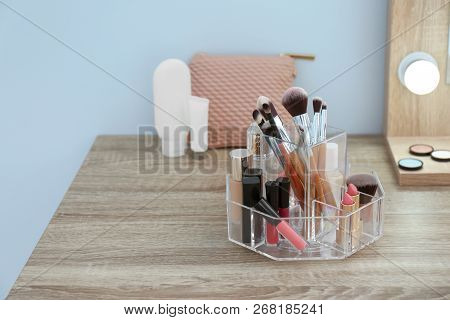 Organizer With Cosmetic Products For Makeup On Table