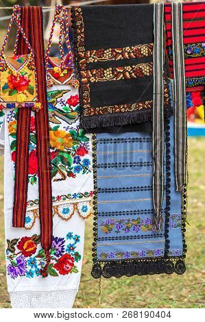 Background With Traditional Bags, Belts And Material Embroidered, Decorated With Specific Patterns O