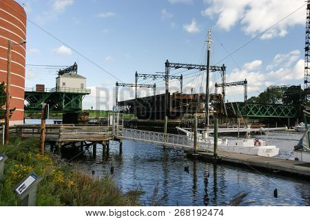 NORWALK, CT, USA-OCTOBER 16, 2005: Rail road bridge with workers near Maritime Aquarium. It was swing bridge built in 1896 for the New York, New Haven and Hartford Railroad.