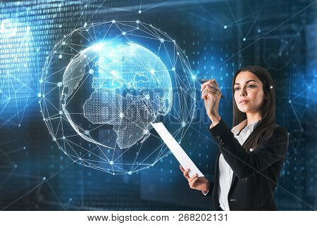 Businesswoman With Polygonal Globe Standing On Blurry Blue Background. Global Business And Future Co