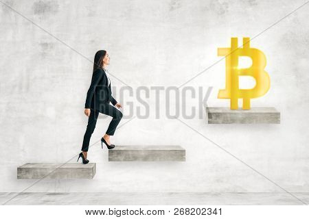 Side View Of Young Businesswoman Climbing Concrete Stairs Leading To Bitcoin. Cryptocurrency And Inn