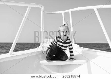 Sea Journey. Baby Boy Enjoy Vacation On Cruise Ship. Child Cute Sailor Yacht Sunny Day. Boy Adorable