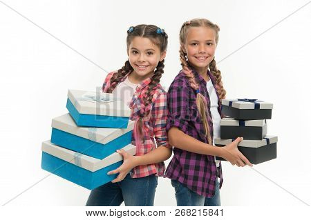 Children Excited About Unpacking Gifts. Small Girls Sisters Received Birthday Gifts. Dreams Come Tru