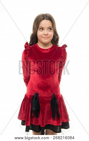 Fashion Concept. Kid Adorable Smiling Posing In Red Velvet Dress. Kids Fashion. Girl Cute Child Wear