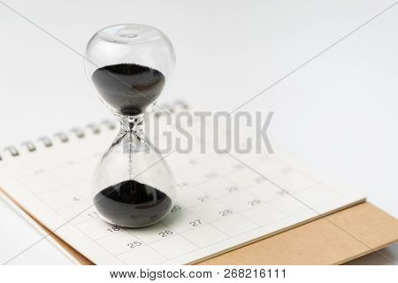 Sand Glass Or Hour Glass On White Clean Desktop Calendar With White Background And Copy Space Using