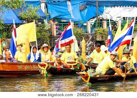 Samutsakorn, Thailand - July 27, Thai People In Parades Traditional Of Candles To Temple At Katumban
