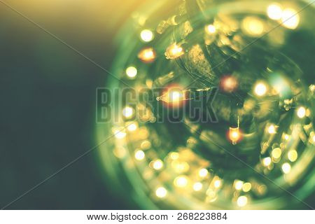Yellow String Lights With Bokeh Decor In Outdoor Restaurant, Blurred Light Bokeh With Tree Backgroun