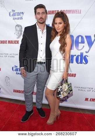 LOS ANGELES - OCT 28:  Neiko Alexander and Kerri Kasem arrives for the Carney Awards 2018 on October 28, 2018 in Santa Monica, CA