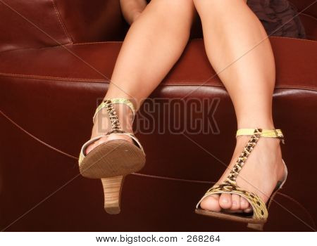 Woman's Legs In Fancy High Hills