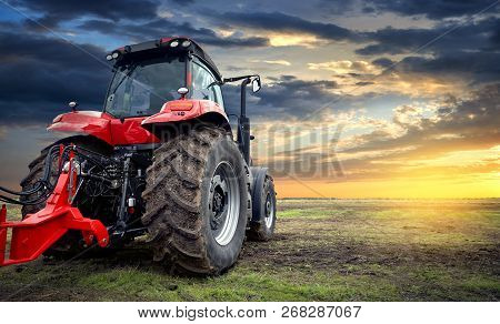 Tractor Working On The Farm, A Modern Agricultural Transport, A Farmer Working In The Field, Tractor