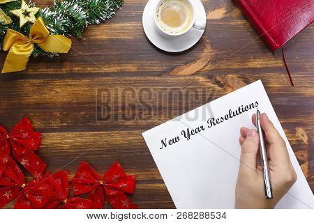 New Year Resolutions List Lying On Wooden Board. Man Making Goal List Flat Lay