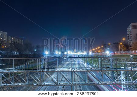 Railway metropolis with a developed infrastructure and night lighting poster